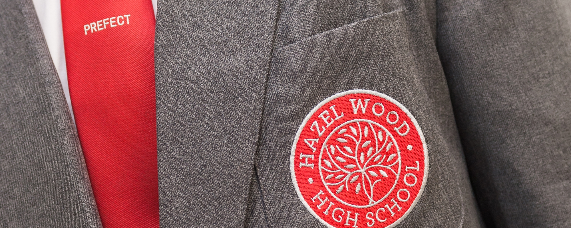 Hazel Wood High School uniform close up